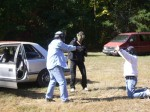 Multiple assailant carjacking scenario at TDI.  This is a bad time to make a move for your gun!