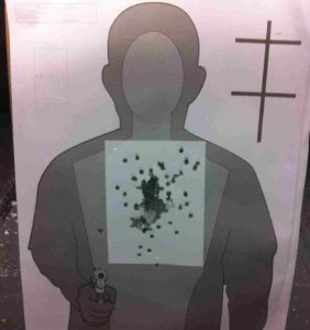 "Target from the Glock 21. the 2 misses came when I was trying to push the ""Bill Drill"" time below 2 seconds."