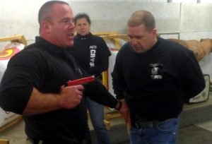 Teaching how to foul a draw and access your own pistol