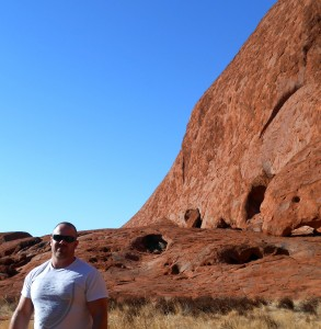 In front of Uluru, the largest rock in the world.