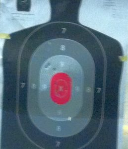 My new student's first magazine at 10 feet. It's a fuzzy cell phone pic under crappy indoor range lighting, but I think she did pretty well!