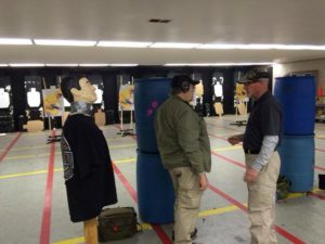 "Dave briefing a student before the ""robot"" drill.  Robot on left.  From Handgun Combatives Facebook Page."