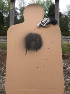 """As a side note, here are the results from part of my (Greg's) weekend practice session. Smith and Wesson 317 .22 revolver. 8 shots each at 25, 35, and 50 YARDS. All fired as fast as I could pull the trigger and reacquire a sight picture. 23 in center mass and one in an arm. Does anybody want to say my .22 snub is a """"mouse gun"""" when I can put 8 shots into your chest in 5 seconds at 50 yards?"""