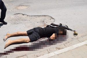 Tunisian active killer.  Note home made hand grenade and detonator near the body.  Photo from The Daily Mail
