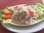 Amazing fish ceviche lunch at a sidewalk cafe in Lima