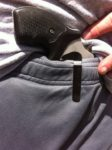 S&W 317 clipped into waistband of gym shorts