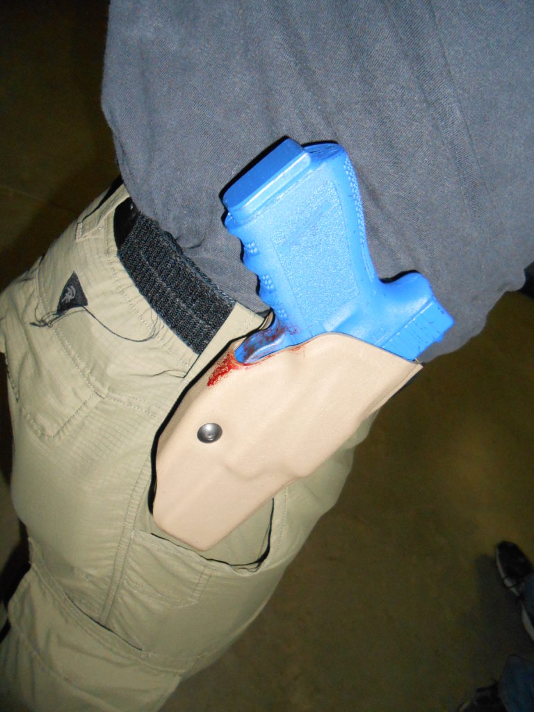 "Author's Safariland ALS retained the gun during an intense struggle in a training class. The ""bad guy's"" blood on the holster demonstrates the struggle's intensity"