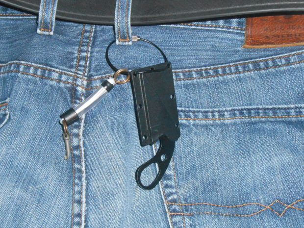 LDK knife attached to keyring and belt loop. The knife is then pushed inside the waistband of the pants and is easily missed on a casual search.