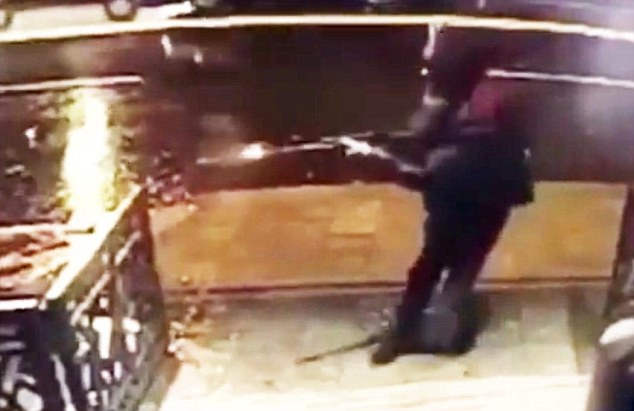 The terrorist firing his AK in the nightclub (from the linked Daily Mail article).